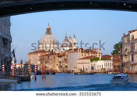 view of famous Canal Grande and Basilica di Santa Maria della Salute in Venice, Italy - stock photo