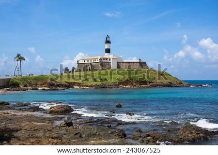 View of famous Farol da Barra (Barra Lighthouse) in Salvador, Bahia, Brazil.  - stock photo