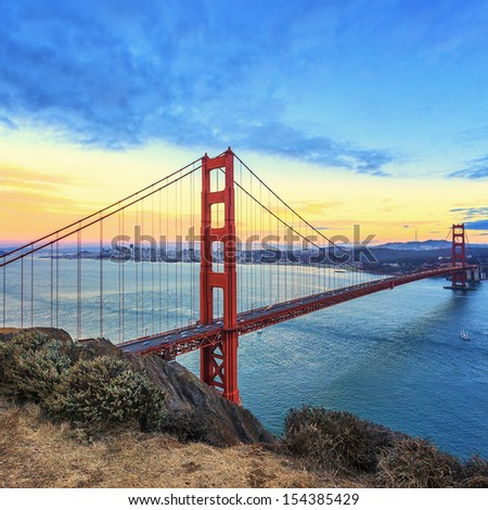 view of famous Golden Gate Bridge at sunset in San Francisco, California, USA  - stock photo