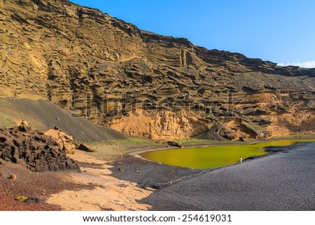 View of famous green water Lago Verde lake, El Golfo, Lanzarote, Canary Islands, Spain - stock photo