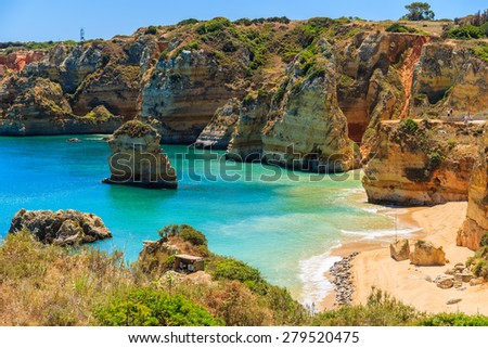 View of famous Praia Dona Ana beach with turquoise sea water and cliffs, Portugal - stock photo
