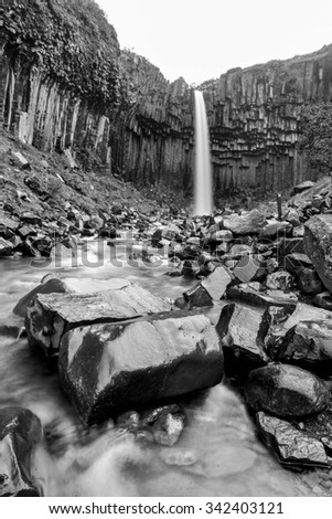 View of famous Svartifoss (Black Fall) in Skaftafell National Park, southeast Iceland in black and white - stock photo