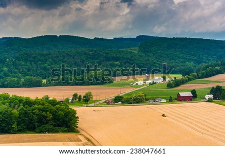 View of farm fields and distant mountains from a roadside overlook near Benton, Pennsylvania. - stock photo