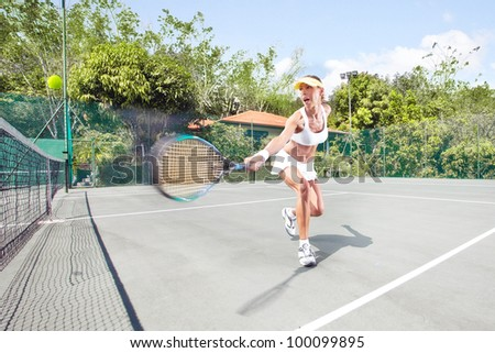 view of female  tennis player on  color back