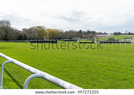 View of fences at Cheltenham Racecourse.  - stock photo
