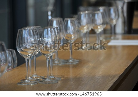 View of few wineglasses on a wood table before banquet.
