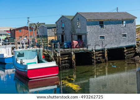 View of fishing boats and sheds at the quaint fishing village of Peggy's Cove near Halifax, Nova Scotia, Canada