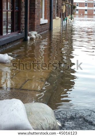 View of flooding from River Ouse on York street. North Yorkshire, UK. - stock photo