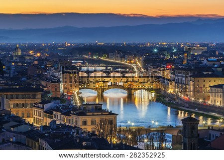 view of Florence with Ponte Vecchio in evening from Michelangelo hill, Italy - stock photo
