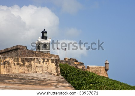 View of Fort Morrow and lighthouse from the wall. - stock photo