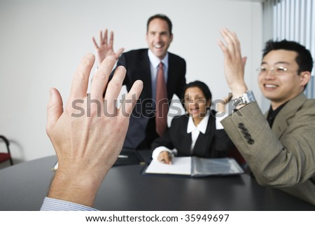 View of four businesspeople in an office meeting. - stock photo