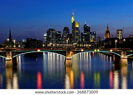 View of Frankfurt am Main skyline at sunset in Germany. It is a dynamic and international financial and trade city with the most imposing skyline in Germany. - stock photo
