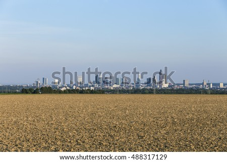 view of Frankfurt skyline with fields in late afternoon