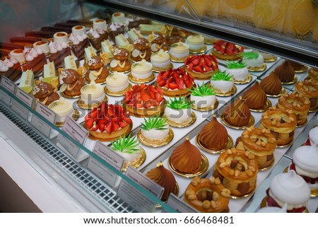 View of French pastry set in cool shelf