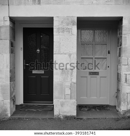 View of Front Doors of Neighbouring Old English Town Houses  - stock photo