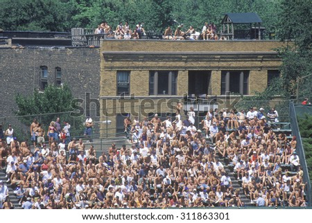 View of full bleachers, full of fans during a professional Baseball Game, Wrigley Field, Illinois - stock photo