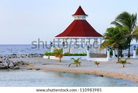 View of gazebo on the beach for weddings, Jamaica. - stock photo