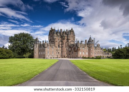 View of Glamis Castle in Scotland, United Kingdom. Glamis Castle is situated beside the village of Glamis in Angus. It is the home of the Countess of Strathmore and Kinghorne, and is open to public. - stock photo