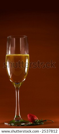 view of glass of sparkling wine and strawberry beside