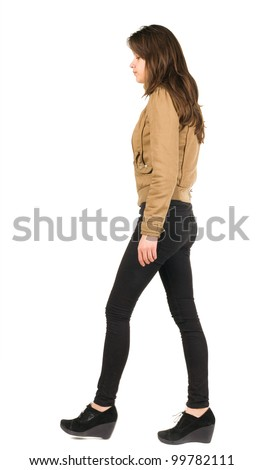 view of going girl. woman in motion. Rear view people. Isolated over white background.The view from the side.