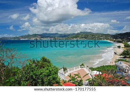 View of Grand Anse beach and tropical coast of Grenada island from coastal promenade - stock photo