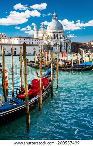 View of Grand Canal in Venice, Italy, with colorful gondola boats in the foreground - stock photo