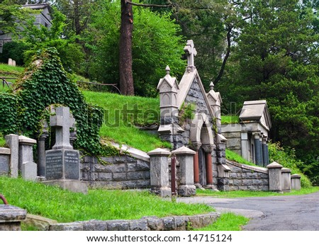 View of graveyard headstones and mausoleums.