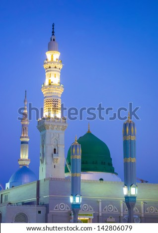 View of green dome of Nabawi Mosque in the morning during sunrise in Al Madinah, Saudi Arabia. - stock photo