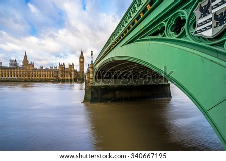 View of green Westminster Bridge, parlament and Big Ben in London, England - stock photo