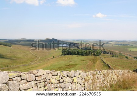 View of Hadrian's Wall from the top of Green Slack on the Winshields Crags looking East towards Steel Rigg and Crag Lough - stock photo