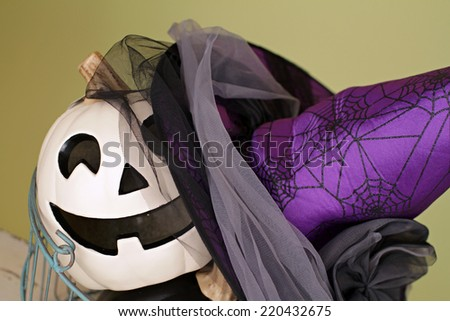 View of Halloween Pumpkins in a wire basket on a rustic wood bench - stock photo