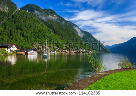View of Hallstatt lake in morning light and clouds on blue sky, Austria