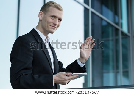 View of happy businessman during break, outdoors