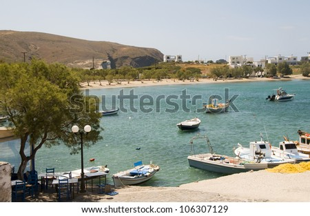 view of harbor and beach fishing village of Pollonia Milos Cyclades Greek island Greece