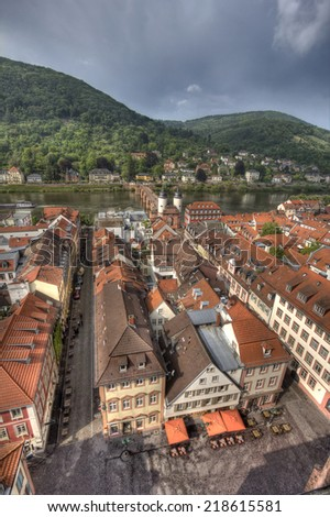 View of Heidelberg and the Neckar river in Germany from the church tower of the Heiliggeist church, church of the Holy Spirit - stock photo