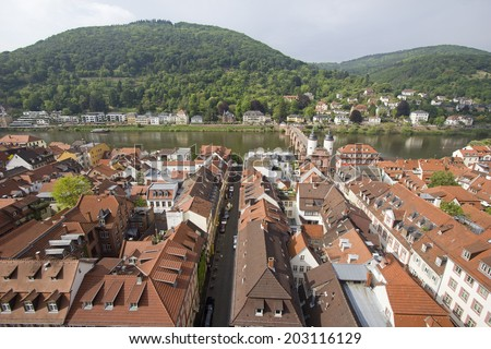 View of Heidelberg and the Old Bridge across the Neckar river, seen from the top of the tower of the Holy Spirit church in Heidelberg, Germay - stock photo
