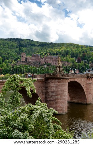 View of Heidelberg Castle in Lush Green Hillside Overlooking Quaint Town of Heidelberg, with Old Bridge in Foreground, Baden-Wurttemberg, Germany - stock photo