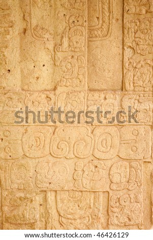 View of hieroglyphs carved into the front of Stela J at the ancient Mayan city of Copan. Honduras, Central America. - stock photo