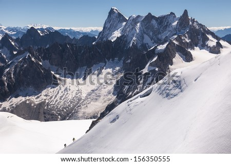 view of high alpine mountains and valley - stock photo