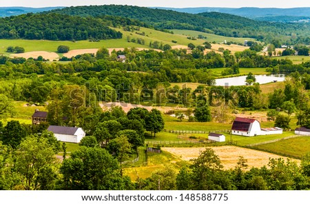 View of hills and farmland in Virginia's Piedmont, seen from Sky Meadows State Park. - stock photo