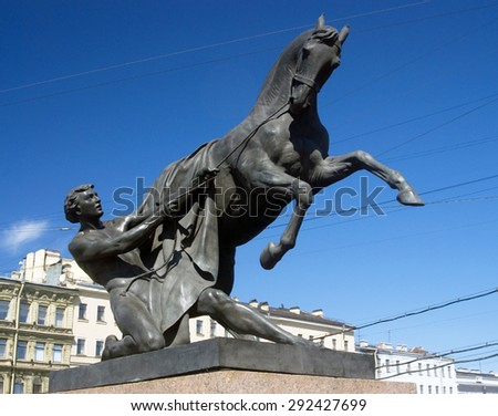 View of Horse tamers monument by Peter Klodt on Anichkov Bridge in Saint-Petersburg Russia. Popular touristic landmark. - stock photo
