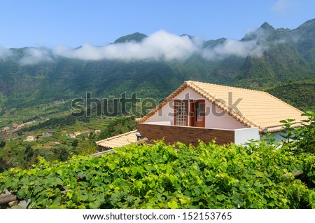 View of house and vineyard in mountain village in northern part of Madeira island, Portugal - stock photo