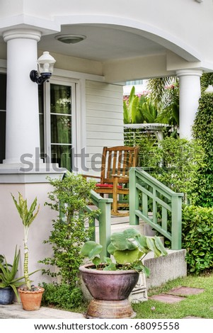 view of House porch with  furniture and flowers - stock photo