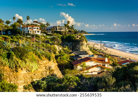 View of houses and the beach from a cliff in San Clemente, California. - stock photo