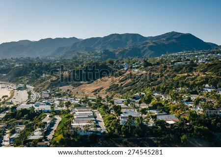View of houses and the Santa Monica Mountains in Pacific Palisades, California. - stock photo