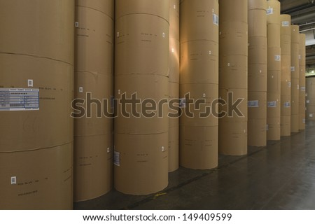 View of huge rolls of paper in newspaper factory - stock photo