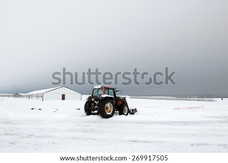 View of Icelandic countryside and farmlands during winter - stock photo
