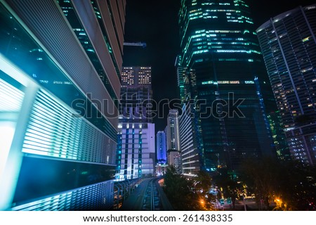 View of Illuminated City at Night from Speeding Metromover Transit System in Miami, Florida, USA - stock photo