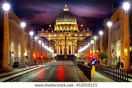 View of illuminated Saint Peter Basilica and Street Via della Conciliazione, Rome, Italy - stock photo