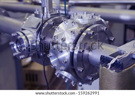 View of Important electronic and mechanical parts in ION Accelerator command room, CNC machined parts, selective focus, industrial blue toned   - stock photo